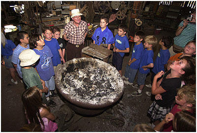 Rubel Castle. The forge inside the machine shop. Dick Macy explains how things were done.