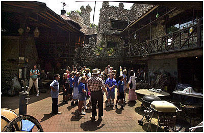 Dick Macy with the Cullen students in the courtyard of Rubel Castle.