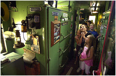 Cullen Elementary Students inside the caboose parked outside Rubel Castle.